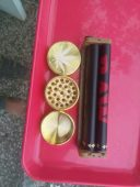 a 3 part grinder and a raw roller to roll you joints and a tray
